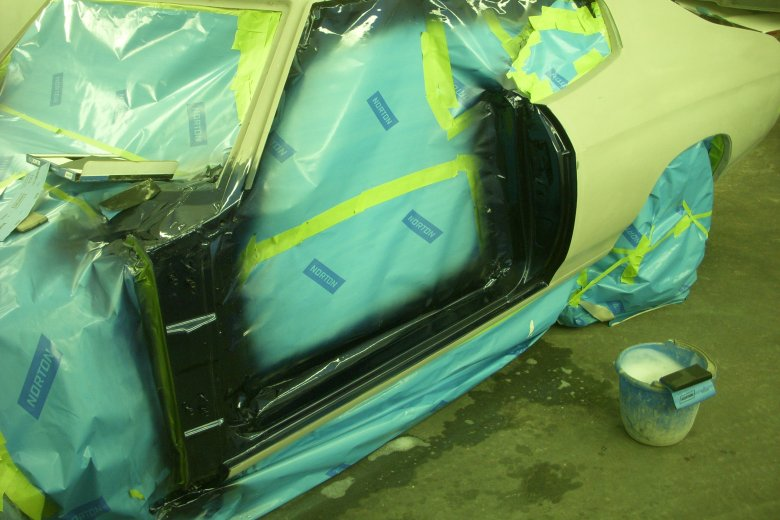 We decided to paint the hard to get areas of the car, like the door jams, with the car apart.