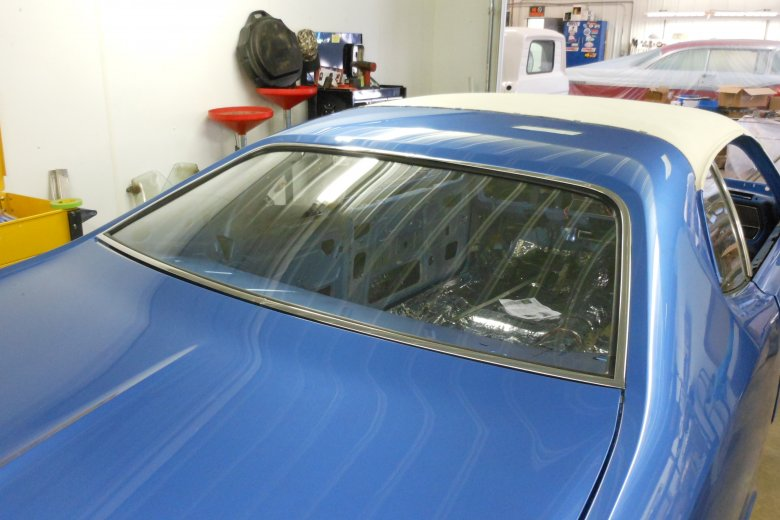Here we put in the rear window and stainless trim.