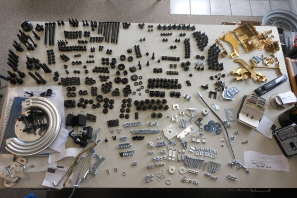 Here we have all the bolts, nuts, washers, screws, and other parts back from the plater and sorted so they can all be put back on the car just as they came off.