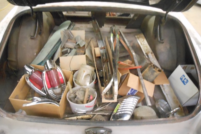 Many pieces that were taken off the car were put into the trunk.