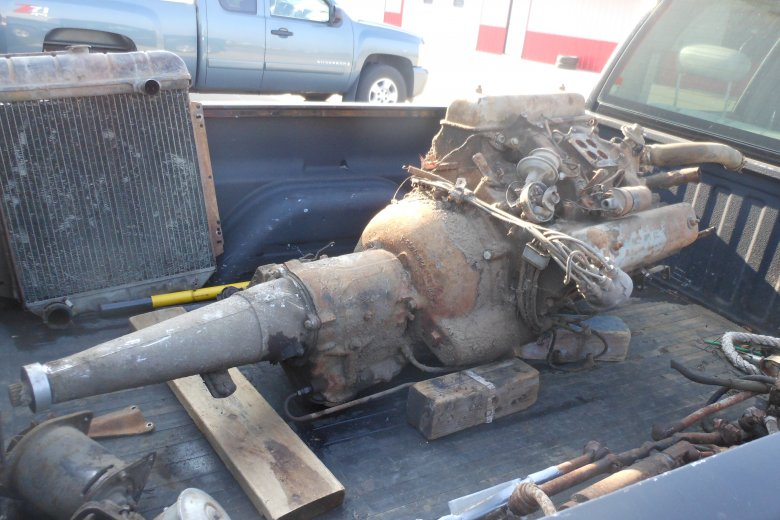 Here is the motor and transmission in the back of the truck.