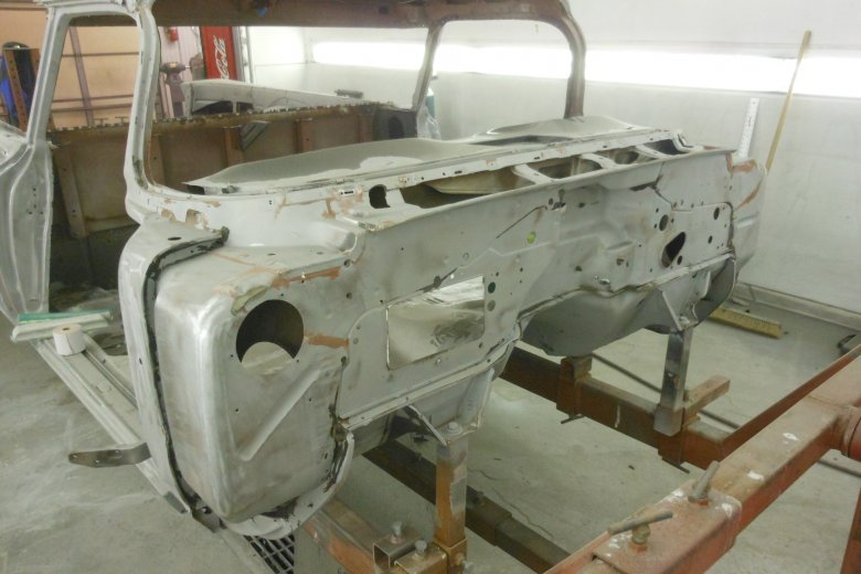 Here is the body after sandblasting everything that wasn't already stripped including the entire underside of the car.