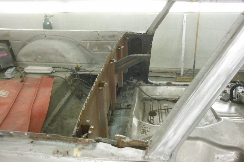 Here we had to completely cut out the lower rear window sill and the package tray because they were so rusted.