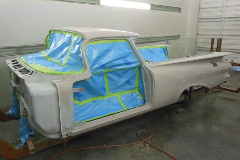 Here is the car after being wet sanded and masked for paint.